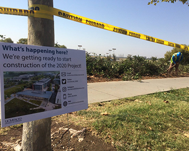 Signage updates passersby regarding the 2020 Project.