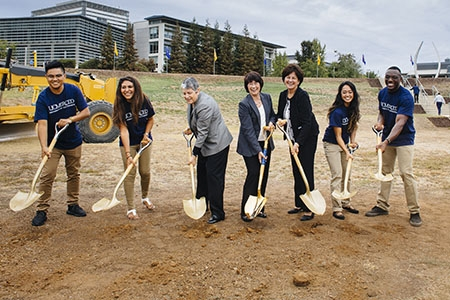 UC President Janet Napolitano (center left), UC Merced Chancellor Dorothy Leland (center) and UC Board of Regents Chairwoman Monica Lozano (center right) and UC Merced students ceremonially break ground to kick off the Merced 2020 Project.