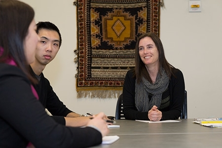 UC Merced Professor Nancy Burke is pictured with two students.