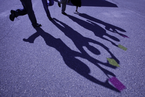 The shadows of four individuals is cast on the ground at UC Merced.