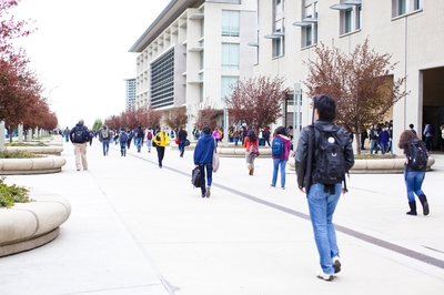 Students walk along Scholars Lane at UC Merced.