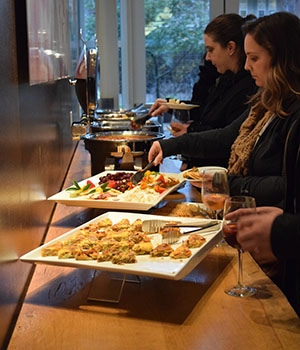 Staff members enjoy appetizers during a fundraiser for the Staff Assembly scholarship fund.