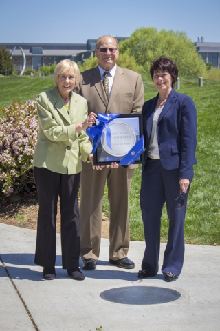 "From left: Elizabeth Wallace, Joel ""Bud"" Wallace and Chancellor Dorothy Leland"