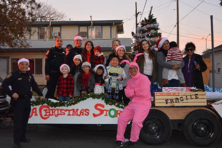 Members of the UC Merced Police Department and their family members, pictured on their holiday float.