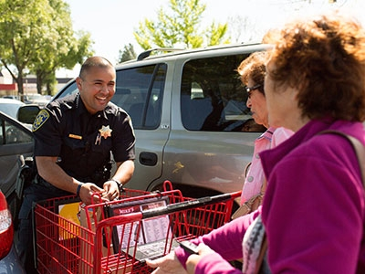 Law enforcement personnel bagged groceries and escorted customers to their car for donations.
