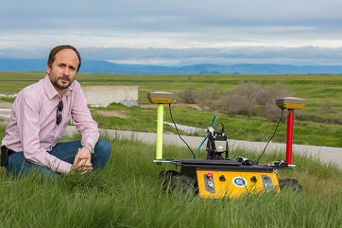 UC Merced Professor Stefano Carpin and one of his robots