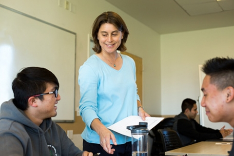 Professor Ashlie Martini works with some of her Design Thinking students.