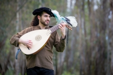 "A performer plays a lute for UC Merced's "" Shakespeare in Yosemite"" events in April."