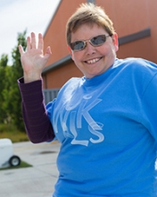 Angi Baxter waves as she takes a stroll during the UC Walks event in May.