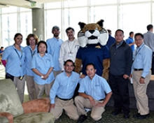 Staff members pose with UC Merced mascot Rufus Bobcat during the Staff Appreciation Week breakfast.
