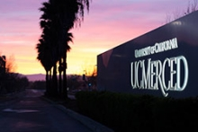 View of the UC Merced sign at sunset