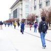 Students are shown walking on Scholars Lane at UC Merced.