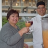 Debbie Henderson and Executive Chef Mitch Vanagten toast with sangria during a fundraiser for the Staff Assembly Scholarship Fund