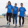 Three people take a stroll during the UC Walks event at UC Merced.