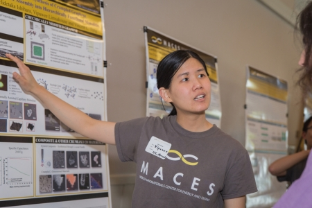 A student explains her research poster at this year's MACES open house.