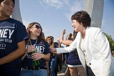 Chancellor Dorothy Leland greets students at Beginnings.