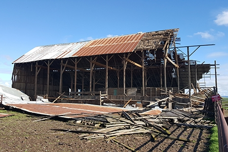 The barn east of campus sustained severe and irreparable damage during last month's storms.