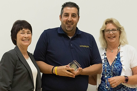 2016 Excellence Award winner Mort Peyvandi, center, stands between Chancellor Dorothy Leland and Staff Assembly President Pam Taylor.