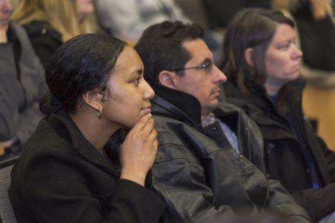 Staff members listen attentively during the Annual Staff Meeting.