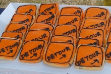 Cookies resembling detour signs on display at the groundbreaking ceremony.