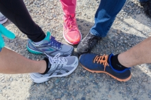 Several staff members put their best foot forward in athletic shoes.