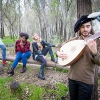 UC Merced Professor Katherine Brokaw rehearses outdoors in the woods with student performers.
